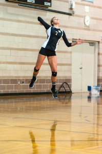 Addy Lofstedt leaps for a serve in a preseason scrimmage at Monarch High School
