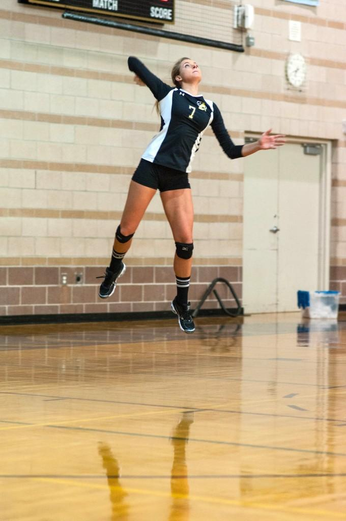 Addy+Lofstedt+leaps+for+a+serve+in+a+preseason+scrimmage+at+Monarch+High+School
