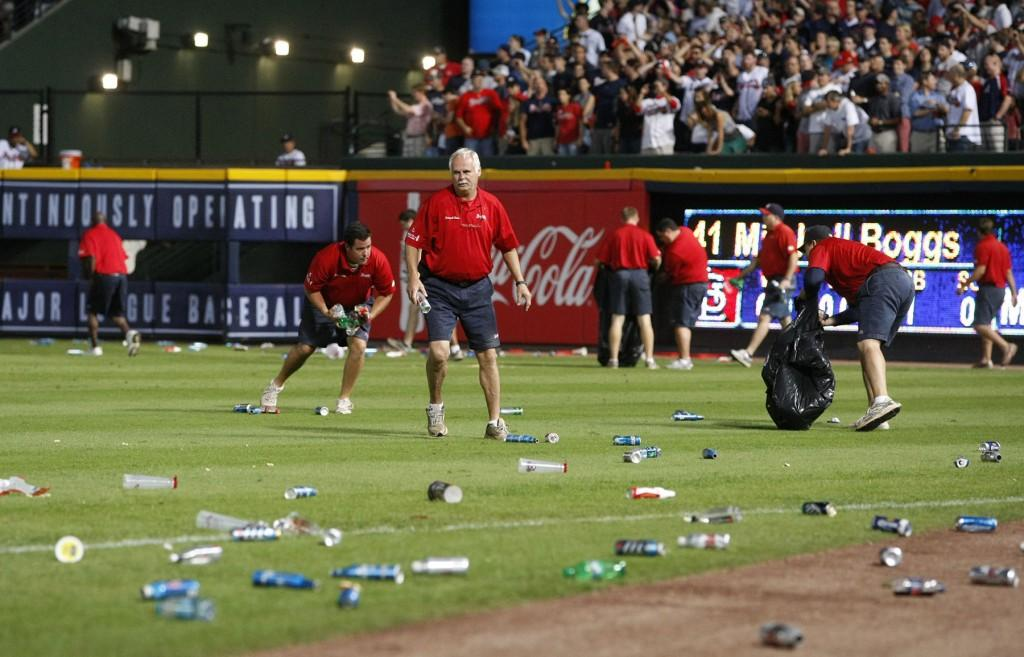 Atlanta+Braves+ground+crew+members+clean+trash+off+the+field+after+fans+littered+the+area+protesting+an+infield+fly+rule+call+on+the+Braves%27+Andrelton+Simmons+in+the+eighth+inning+against+the+St.+Louis+Cardinals+in+the+National+League+Wild+Card+game+at+Turner+Field+in+Atlanta%2C+Georgia%2C+Friday%2C+October+5%2C+2012.+Officials+ruled+Simmons+out+on+the+infield+fly+rule.+The+Cardinals+defeated+the+Braves%2C+6-3.
