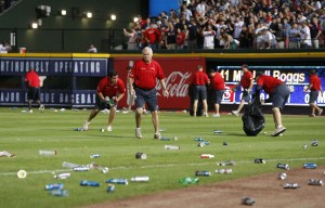 Atlanta Braves ground crew members clean trash off the field after fans littered the area protesting an infield fly rule call on the Braves' Andrelton Simmons in the eighth inning against the St. Louis Cardinals in the National League Wild Card game at Turner Field in Atlanta, Georgia, Friday, October 5, 2012. Officials ruled Simmons out on the infield fly rule. The Cardinals defeated the Braves, 6-3.