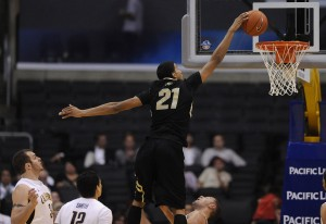 Colorado's Andre Roberson (21) dunks over California's Harper Kamp in the first half of a Pac-12 Tournament semifinal at the Staples Center in Los Angeles, California, on Friday, March 9, 2012.