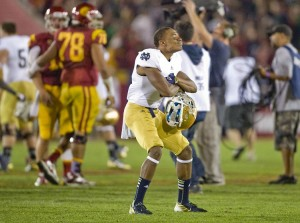 A Notre Dame player strikes a defiant pose as the Fighting Irish celebrate a 22-13 win over USC at the Los Angeles Coliseum on Saturday, November 24, 2012. Notre Dame will play for the National Championship on January 7th, 2013