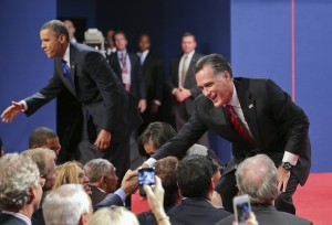 Republican presidential candidat Mitt Romney and President Barack Obama shake hands at the end of the last debate at Lynn University in Boca Raton, Florida on Monday, October 22, 2012.