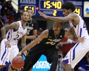 Kansas's Kevin Young, right, stops Colorado's Spencer Dinwiddle during the second half of a men's college basketball game at Allen Fieldhouse on Saturday, December 8, 2012, in Lawrence, Kansas. The Kansas Jayhawks beat the Colorado Buffaloes, 90-54.
