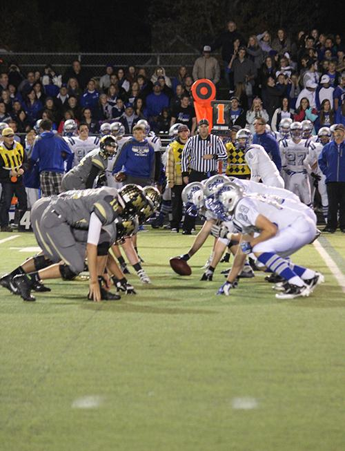 Monarch%27s+defensive+line+prepares+to+rush+the+Broomfield+quarterback+on+October+25th%2C+2013.+The+Broomfield+center+can+be+seen+preparing+to+snap+the+ball+to+the+quarterback.