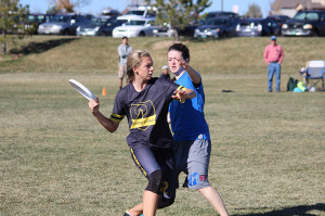 Senior Katie Mintle lunges to pass the disc past a Lakewood High School defender. In the semifinal game at Broomfield County Commons on Sunday, November 10th the Coyotes lost 15-6.