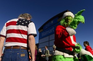 Community and labor groups demonstrate outside a Walmart store in Lakeside on Black Friday, Nov. 29, 2013. They were protesting the nation's largest retailer on the busiest shopping day of the year.