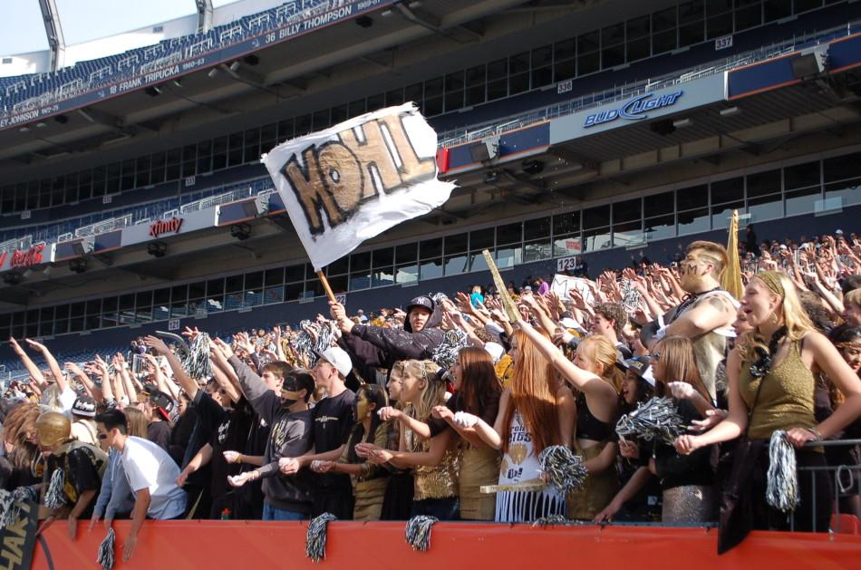 Students+cheer+at+the+2012+state+championship+football+game.+The+fans+certainly+helped+the+Monarch+football+team%2C+who+won+17-14.+%28Charlie+Light%29