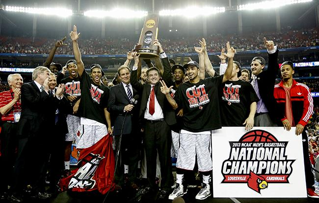 Louisville+Cardinals+head+coach+Rick+Pitino+celebrates+with+his+team+after+defeating+Michigan%2C+82-76%2C+and+winning+the+NCAA+Men%27s+Basketball+Championship+at+the+Georgia+Dome+in+Atlanta%2C+Georgia%2C+Monday%2C+April+8%2C+2013.+