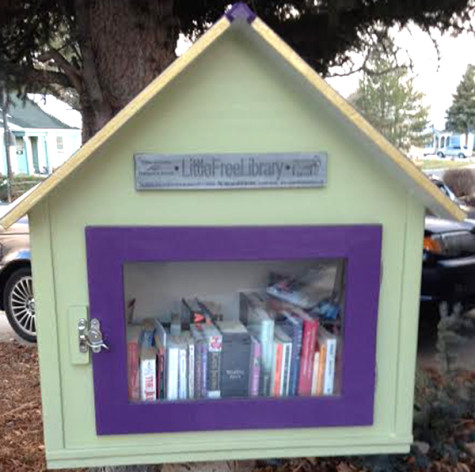 Jeannie Dulaney 's Little Free Library located on 109 South Polk Avenue sits on a tree stump in her front yard.