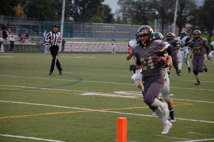 Monarch+running+back+Philip+Bubernak%2C+number+24%2C+runs+the+ball+in+for+a+touchdown+during+Friday+night%27s+game+against+Standley+Lake.+The+Coyotes+won+with+a+final+score+of+43-7.