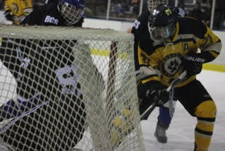 Defenseman Drew Wagner takes a shot at the goal during Monarch's second period offensive run.