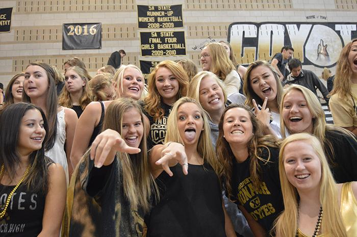 Senior+girls+pose+at+the+Homecoming+assembly.