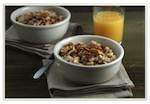A healthy breakfast, such as oatmeal and orange juice, is essential for a good start to the day.