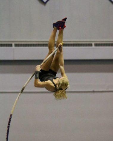 Soaring to new heights! Freshman Mia Manson executes a pole vault.