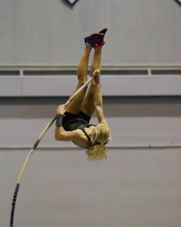 Soaring+to+new+heights%21+Freshman+Mia+Manson+executes+a+pole+vault.+