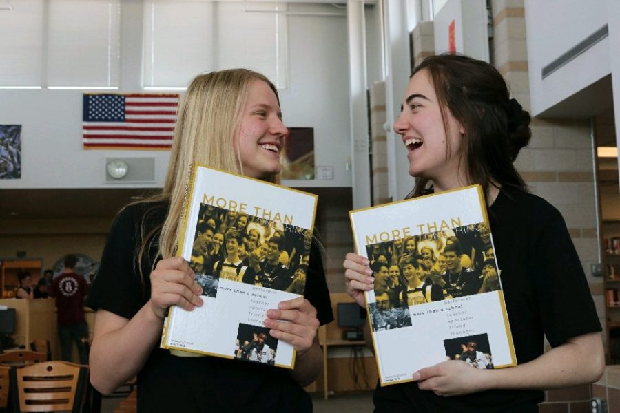 Editor+in+Chief+Emma+Baziuk+and+managing+editor+Ellie+Guanella+celebrate+yearbook+distribution+day+with+a+smile.