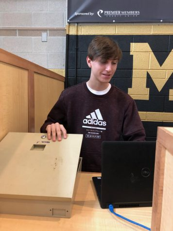 Breccan Corzine '21works as a teller at Premier Members Credit Union.