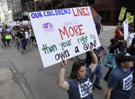 DENVER, CO - MARCH 24: Protesters had up 17th Ave for the March for Our Lives to end gun violence March 24, 2018. The student-led rally and march is one of more than 400 sister demonstrations taking place across the country March 24 in partnership with the Washington DC march that is organized by the student survivors of the February 14 shooting in Parkland, Florida. (Photo by Andy Cross/The Denver Post via Getty Images)