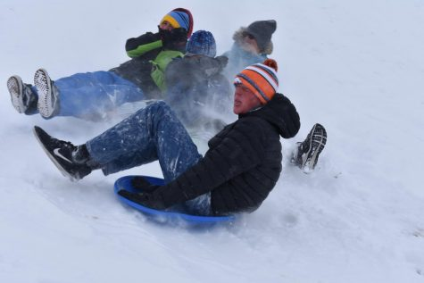 Band member Nathan Dankers '20 and others sled down a hill in Purple Park in Superior. While it was a small consolation for the canceled Marching Band State Championships, the students said they enjoyed the day in the powder.