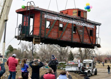 LOUISVILLE, CO - FEBRUARY 29, 2020 -  Louisville's iconic century-old caboose and train cars were removed and moved to a sitE for restoration on February 29, 2020. Dozens of people showed up to watch and be photographed with the caboose. (Cliff Grassmick/Staff Photographer)
