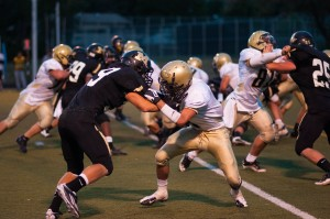 Running back Harrison Leachman (19) sets a block on the outside in Monarch's 32-6 win over Greeley West on August 31st, 2012.