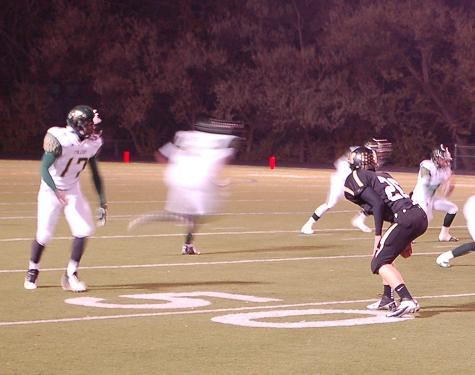 Junior cornerback Jake Hummel (#26) drops into coverage against Falcon's Jamal Maddox. Hummel had a key play in the first quarter, breaking up a pass on fourth-and-two. Junior Ethan Marks scored a touchdown on the very next play.