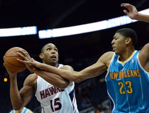 Anthony Davis (right) tries to block a shot from the Atlanta Hawks' Al Horford. Davis' New Orleans Hornets may be changing their team name to the Pelicans after this season. Could other teams, such as the Charlotte Bobcats, start a game of