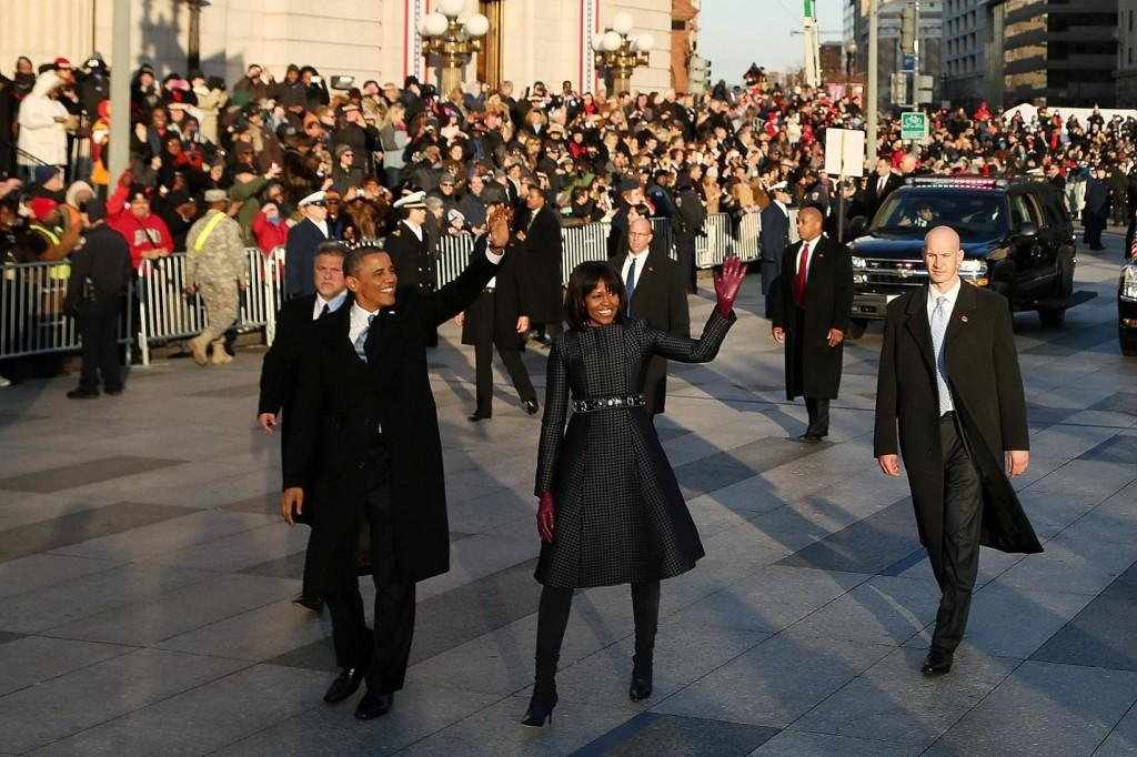 President Barack Obama and first lady Michelle Obama wave at the crowd as the inaugural parade makes it way to the White House on Monday, January 21, 2013 in Washington, D.C.