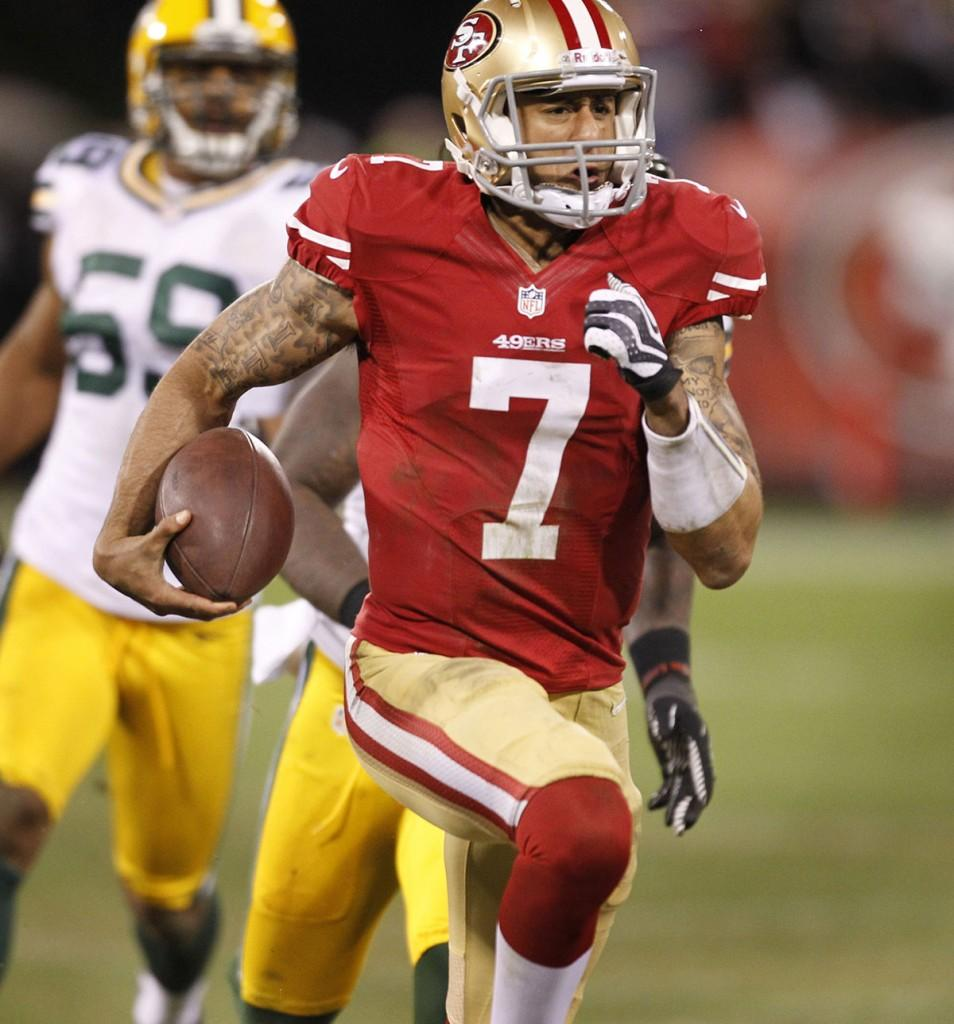 San Francisco 49ers quarterback Colin Kaepernick (7) runs for a touchdown in the third quarter as the San Francisco 49ers beat the Green Bay Packers in the NFC Divisional Playoff on Saturday, January 12, 2013.