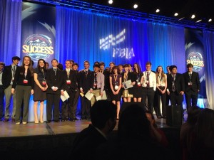 The Monarch FBLA chapter stands on stage after the awards ceremony at the  State Leadership Conference in Vail on April 23rd
