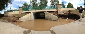 Flood water sits beneath a tunnel connecting the 18th green of Coal Creek Golf Course to the clubhouse area on September 13, 2013