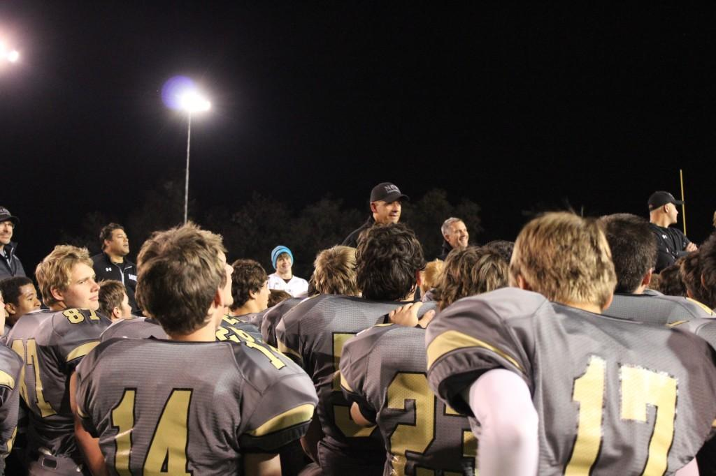 Head Coach Phil Bravo addresses his team after the Monarch vs. Broomfield football game on Friday, October 25th at Warrior Stadium. The Coyotes won the game 48-12.