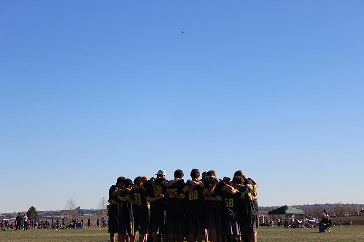 The entire Monarch Ultimate frisbee team huddles up to discuss the loss against Lakewood High School at Broomfield County Commons on Sunday, November 10th.