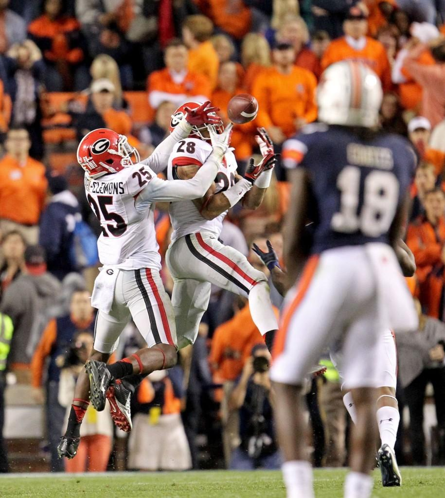 Tray Matthews (28) and Josh Harvey-Clemons (25) of the Georgia Bulldogs tip a pass, but Ricardo Louis of the Auburn Tigers makes the catch scoring the game-winning touchdown at Jordan-Hare Stadium in Auburn, Ala., on Saturday, Nov. 16, 2013. Auburn defeated Georgia, 43-38.