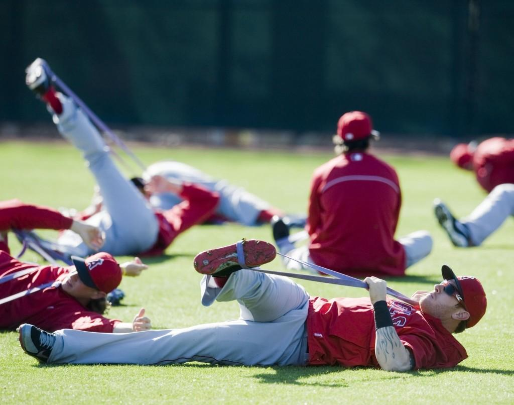 Los Angeles Angels players stretch during spring training last February 2013.