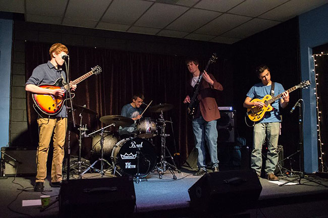 All four members of 'Prime Focus' strike a tune onstage at a recent show in Boulder County. The group is made up of four seniors who currently attend Monarch.