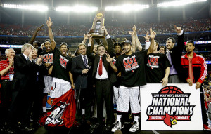 Louisville Cardinals head coach Rick Pitino celebrates with his team after defeating Michigan, 82-76, and winning the NCAA Men's Basketball Championship at the Georgia Dome in Atlanta, Georgia, Monday, April 8, 2013.
