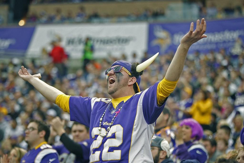 Minnesota fans cheer on their team at halftime against Chicago at the Hubert H. Humphrey Metrodome in Minneapolis, Minn., on Sunday, Dec. 1, 2013. The Vikings defeated the Bears, 23-20, in overtime. (Elizabeth Flores/Minneapolis Star Tribune/MCT)