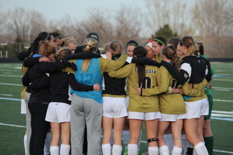 The girls soccer squad huddles up before taking the field for second half action against Fairview on April 4, 2014 at Monarch High School.