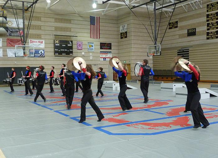 MIP's cymbal line moves across the floor in formation.