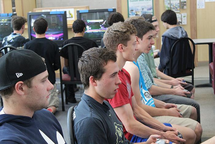 Senior Jackson Elliot battles senior Sam Horton in a friendly match of Super Smash Bros after being knocked out of the tournament.