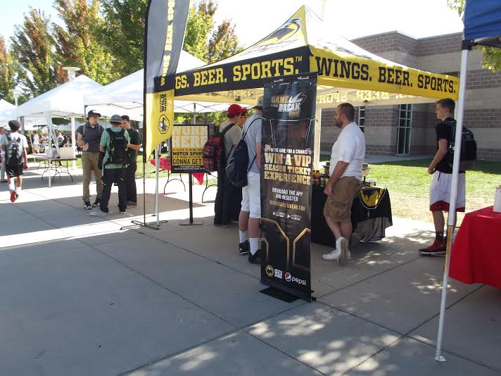 Before Taste of Monarch began, Buffalo Wild Wings set up their booth and began preparing their food for the event. Their booth attracted students before the actual event began.