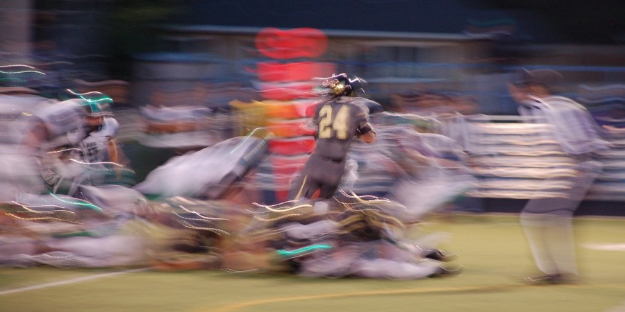 Philip Bubernak leaps over Standley Lake defenders for his fourth touchdown.