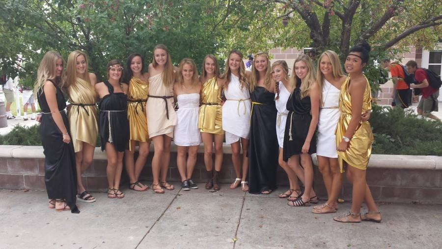 Senior girls pose outside in their togas on Tuesday.