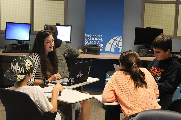 Students work during their Social Studies class in the updated Social Studies lab that is designed to make learning easier and make the space more flexible to both the needs of students and teachers.