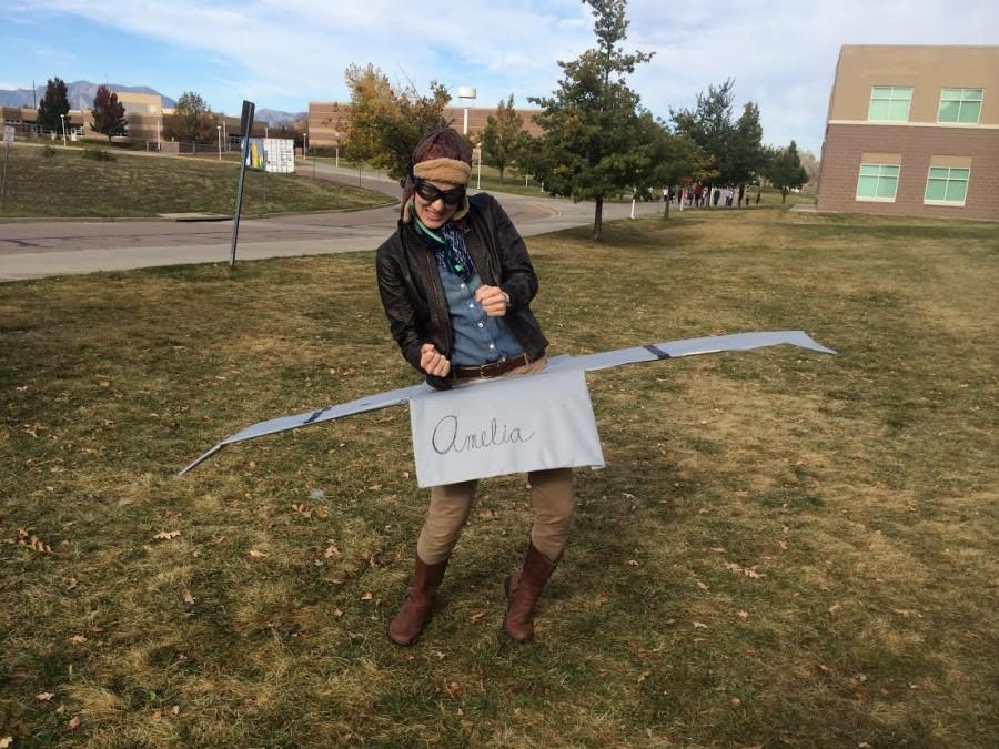 Science teacher Meghan Mosher is all ready for lift-off in her Amelia Earhart costume, complete with a plane.