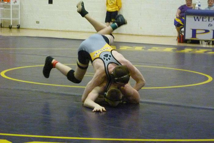 Freshman Nate Pritchard  is in the process of pinning his Boulder High opponent on January 28th.