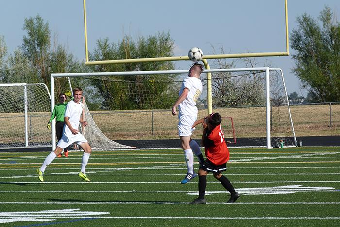 Jason Elzinga a senior who plays defense for Monarch varsity soccer team fires a header to a fellow teammate. Elzinga fired the header in the coyote's second game of the season against Rangeview.