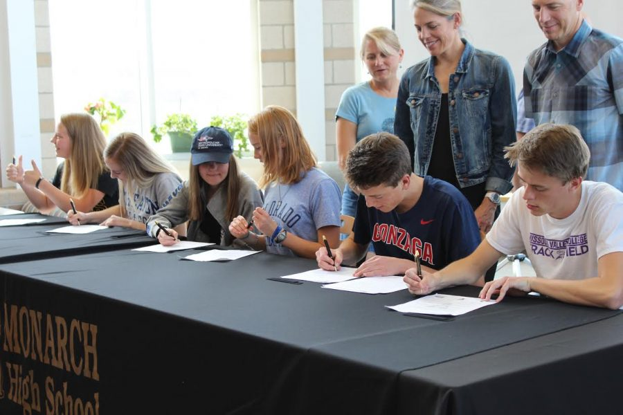 Jessica Kelm, Olivia Burgener, Alden Gruidel, Daisy Fuchs, Ben Hogan, and Riley Sorbo participate in the spring signing ceremony on April 13th.